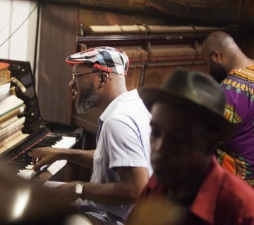 Orrin Evans, left, searches for the right note at CapitalBop's Three-Piano Cutting Contest at the DC Jazz Festival in June. Paul Bothwell/CapitalBop
