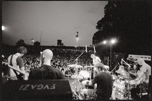 Fugazi performs at Fort Reno in 2002. Courtesy dischord.com