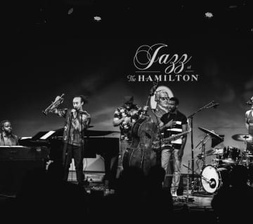 Theo Croker speaks to the audience as his band performs at the Hamilton. Jati Lindsay/CapitalBop