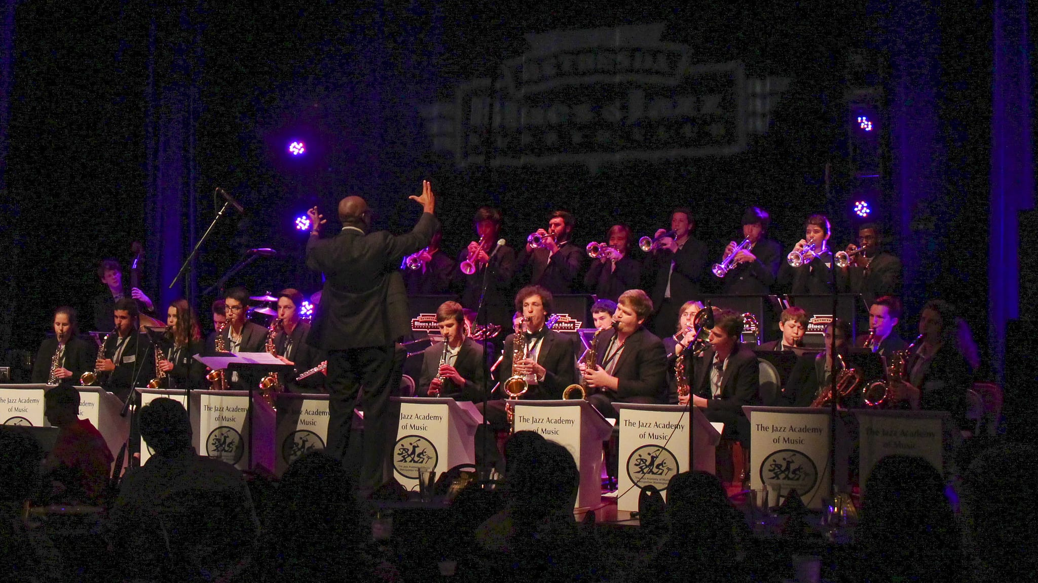 The saxophonist and educator Paul Carr leads his Jazz Academy of Music big band in a 2016 concert at Bethesda Blues & Jazz. Courtesy woodleywonderworks/flickr